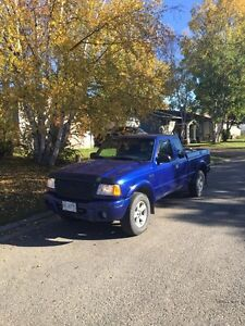 2003 Ford Ranger 4x4 C/W studded winters on rims