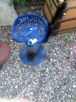 Antique cast and tin tractor seats