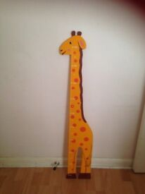 Wall mounted measuring giraffe