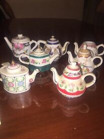 A collection of tiny teapots