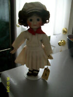 Assorted Porcelain Dolls, Cherubs and other ornaments..