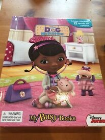 Doc McStuffins girl toy book with playmat and figurines