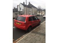 Red Ford Fiesta style 07 plate