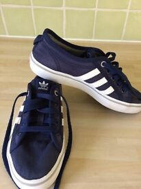 Adidas canvas trainers.