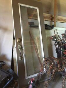 Metal storm door