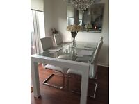 White gloss and glass dining table