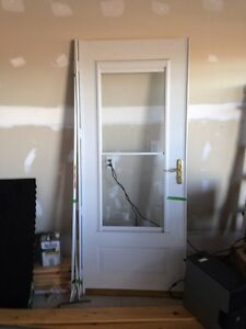 Storm door built in screen