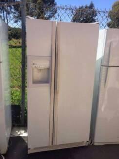 large 605 liter GE side by side fridge with dispenser , can deliv