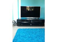 Turquoise rug and cushions to match