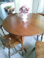 Moving - Must sell!  Wooden kitchen table and chairs.