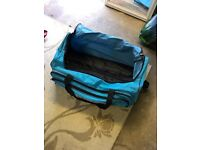 Light blue medium suitcase / hold-all