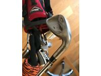 Assorted Golf Clubs and Bag with stand good condition.