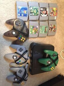 N64 FOUR REMOTES AND MARIO GAMES AND 007