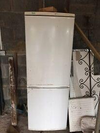 Large upright fridge freezer for sale.