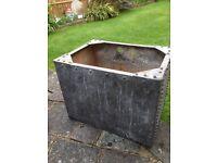Old galvanized water tank garden planter