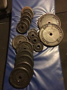 "150 Lbs of Steel Weight Plates with 1"" Hole"