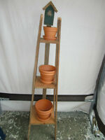 Deck or house plant stand.