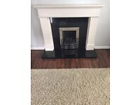 Granite hearth and back with resin surround fireplace