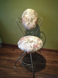 Vintage Swivel Boudoir Chair with metal scroll detailed frame.