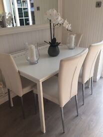 White table and leather chairs