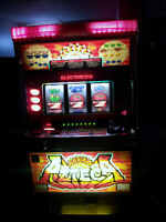 Azteca coin operated slot machine great for bar.