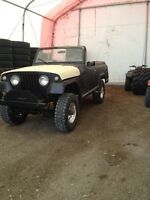 1966 Jeepster odd fire V6 two sets of tires and wheels