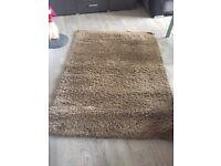 Next brown rug.