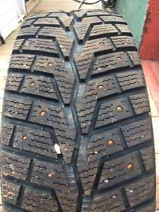 Four studded winter tires 205/55/R16