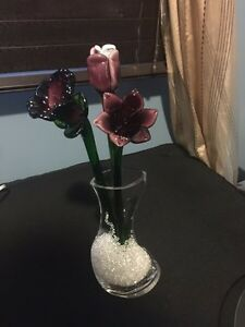 3 glass flowers in a vase