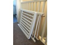white cot, waterproof mattress, bedding set and mobile.