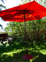 For sale, nearly new crank style umbrella with Red Fabric.