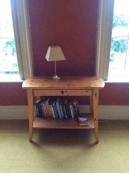 Pine side table with drawer and shelf from Ikeain Lutterworth, LeicestershireGumtree - Pine side table with drawer and shelf. Very good condition. IKEA antique pine stain. Dimensions 107cm (w) x 50 cm (d) x 80 cm (h)