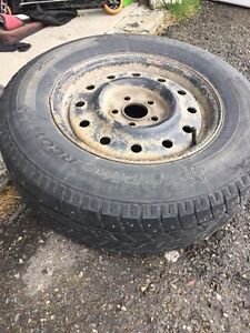 4 studded winter tires and rims - 50 to 60% left 215 70 15 St. John's Newfoundland image 1