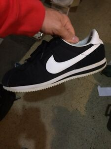 2 pairs of Nike shoes size 14