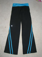 Ivivva yoga pant size 4, black accentuated with blue stripes
