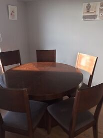 Round wooden dining table and 6 chairs