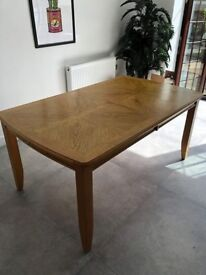 Solid wood eight-seater dining table with removable leaf