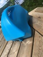 Blue backrest for paddle boat found at one island lake