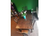 dark wooden table and 6 chairs