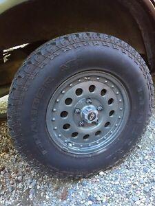 Chevy s10 rims and general grabber at2 tires