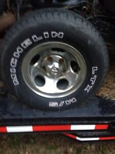 """Set of 4 Dodge 15"""" rims and tires"""