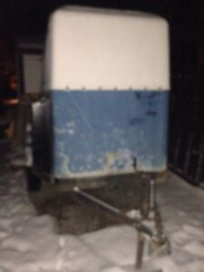 Old looking but perfectly operational enclosed trailer