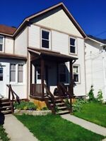 Large 3 bedroom duplex, small yard, parking. Great location.