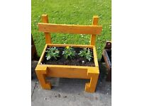 Rustic chair planters with marigolds plants