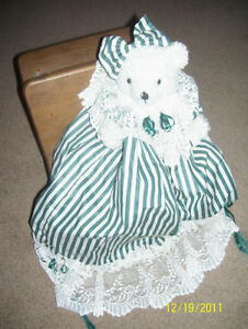 Old fashioned bear hand crafted with lace and bows