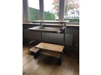 Office desk on wheels (that lock) with a sliding keyboard drawer.