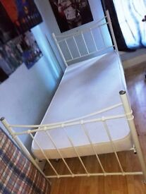 Single cream metal bed frame and mattress