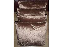 Four Mocha Cushions and One Burnt Orange Cushion