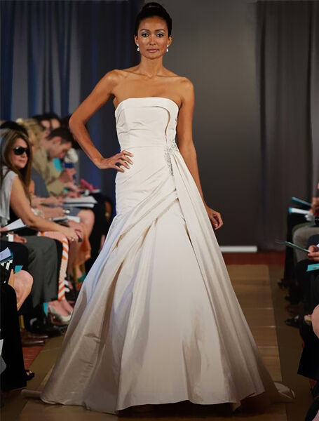 born in italy but launching her career in 1984 in toronto ines di santo is a leading designer of bridal couture her gowns combine a european aesthetic