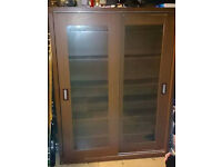 Brown wood-like Bookcase with glass framed doors